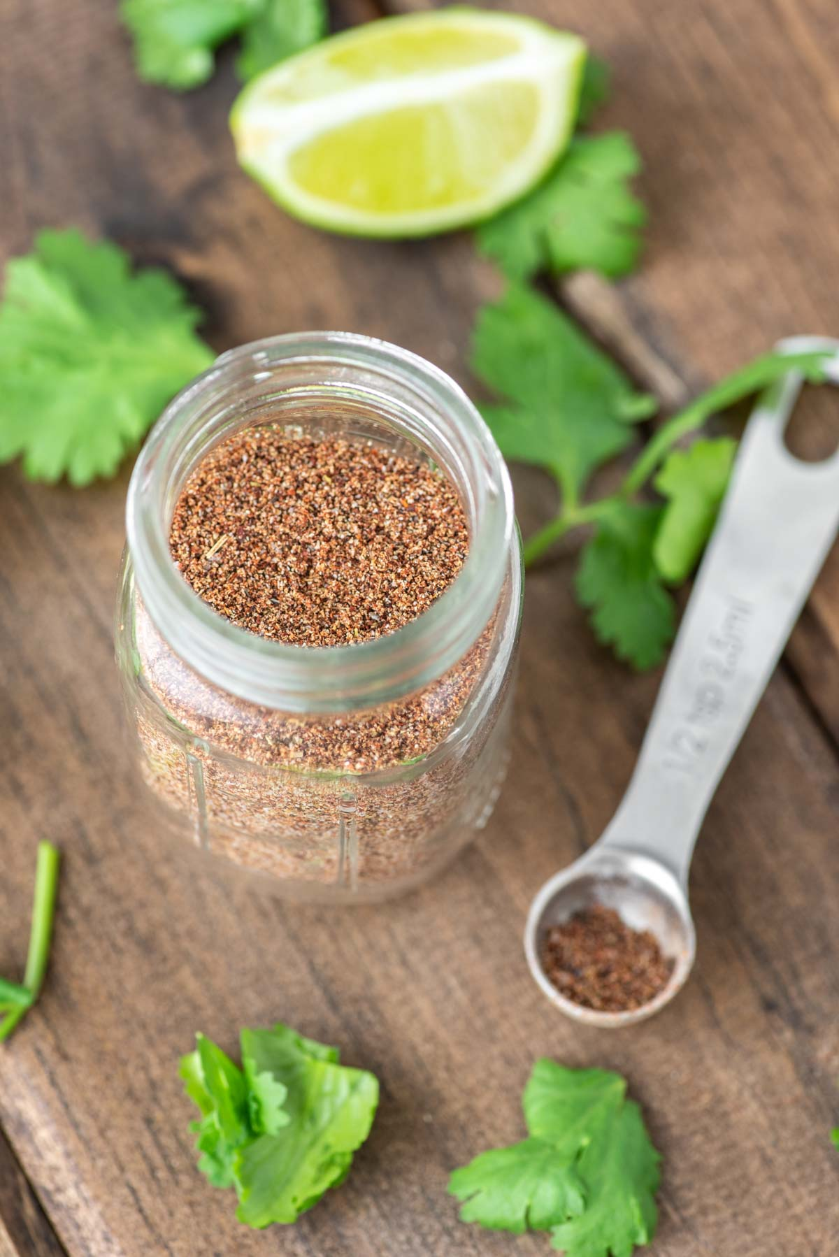 homemade taco seasoning recipe in glass mason jar on wooden board