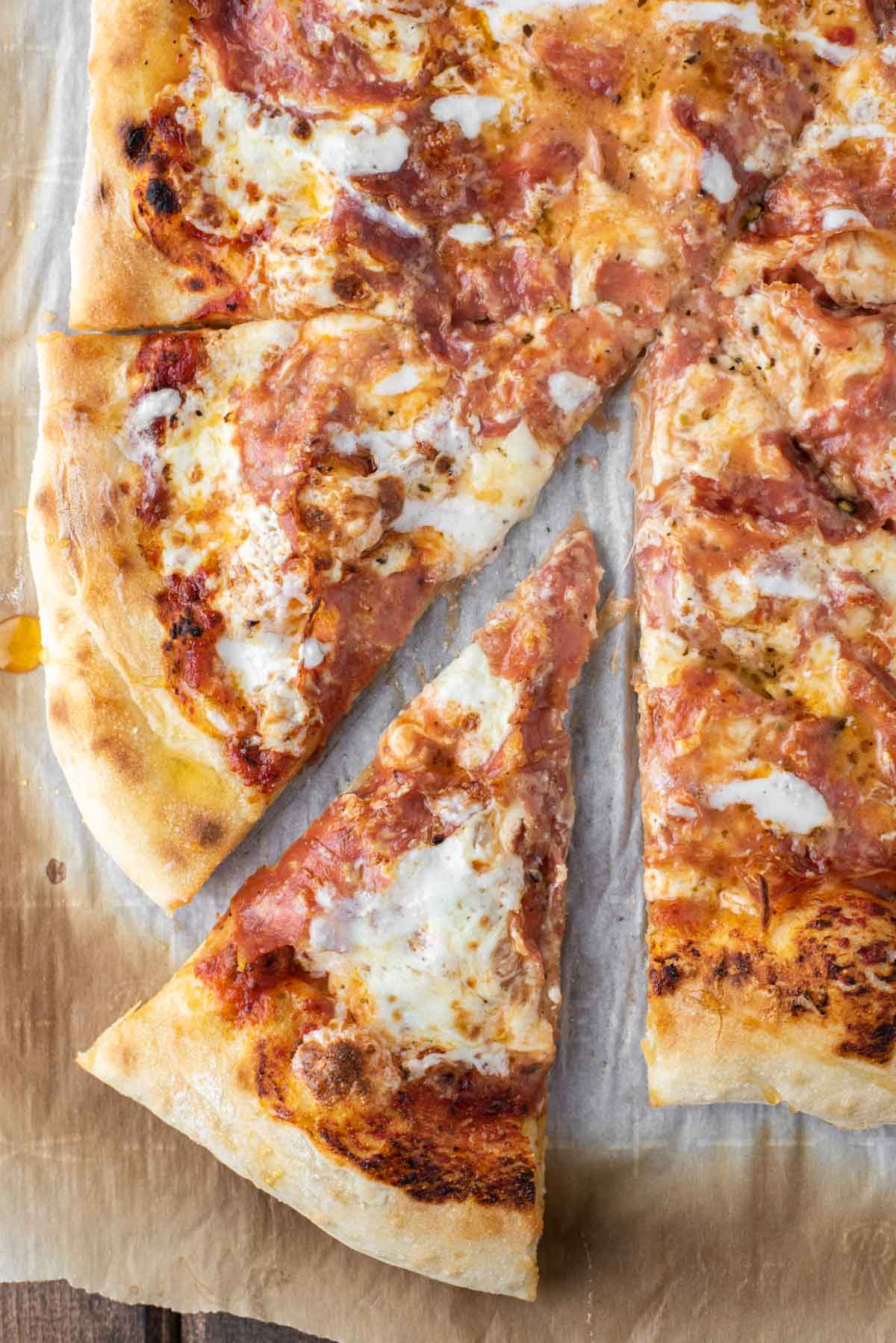 overhead shot of honey-drizzled salami pizza