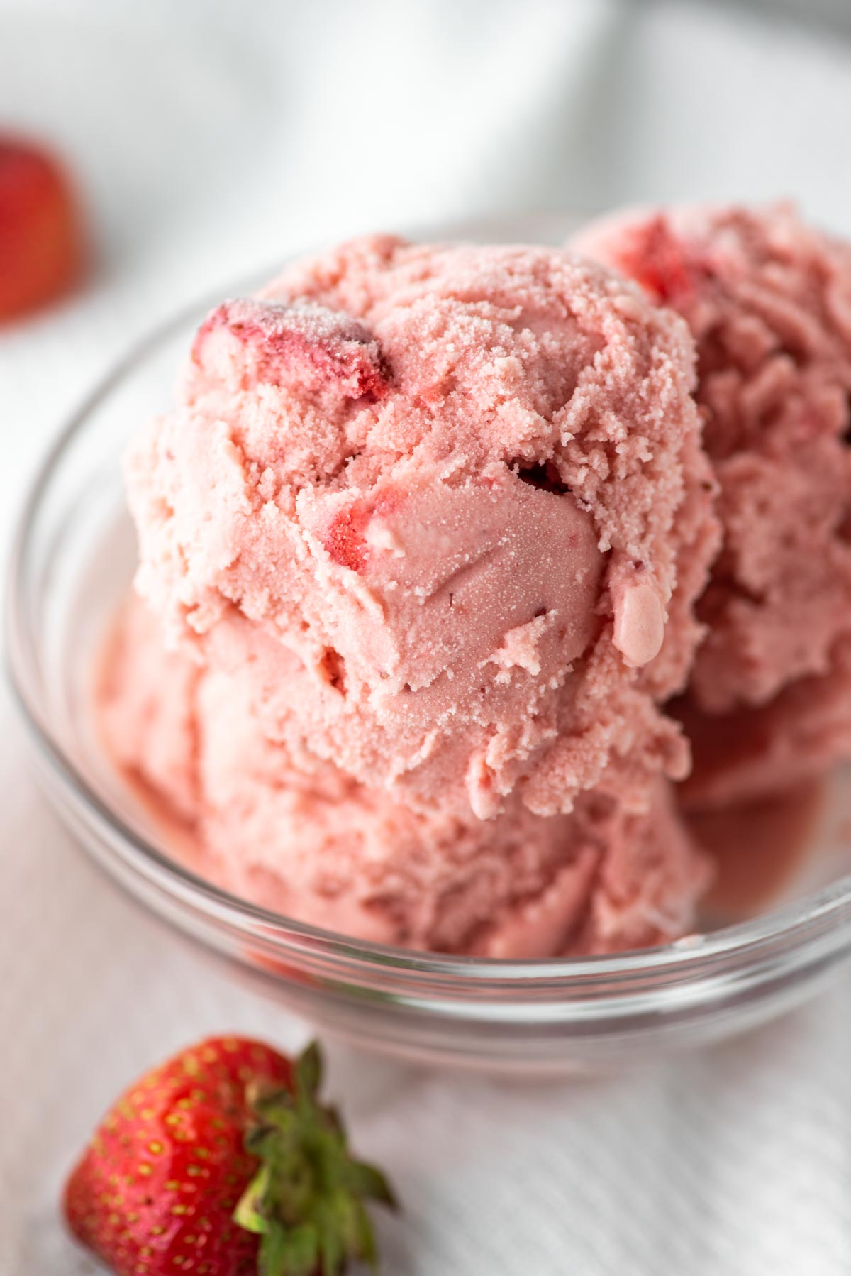 strawberry ice cream in glass bowl