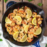 overhead shot of lemon garlic butter shrimp in skillet