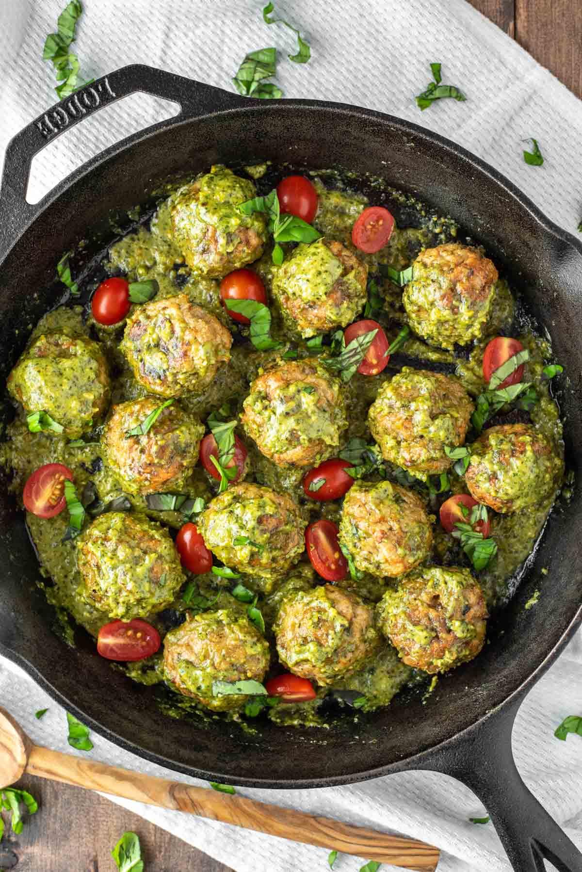 overhead shot of chicken pesto meatballs in skillet