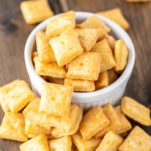 homemade cheese crackers in white ramekin