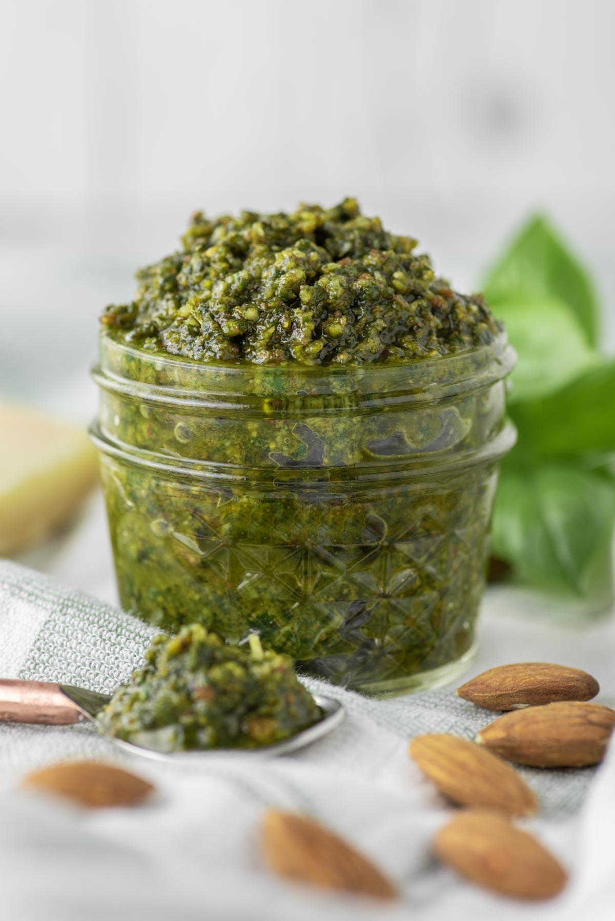 almond basil pesto in glass jar