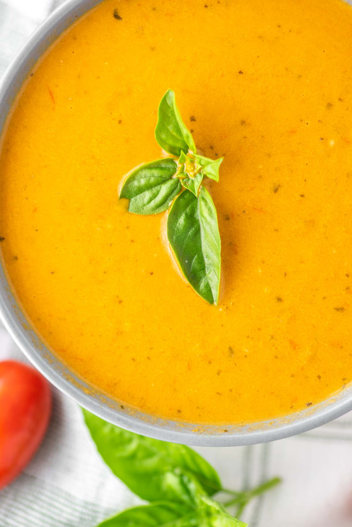 overhead shot of bowl of roasted tomato basil soup