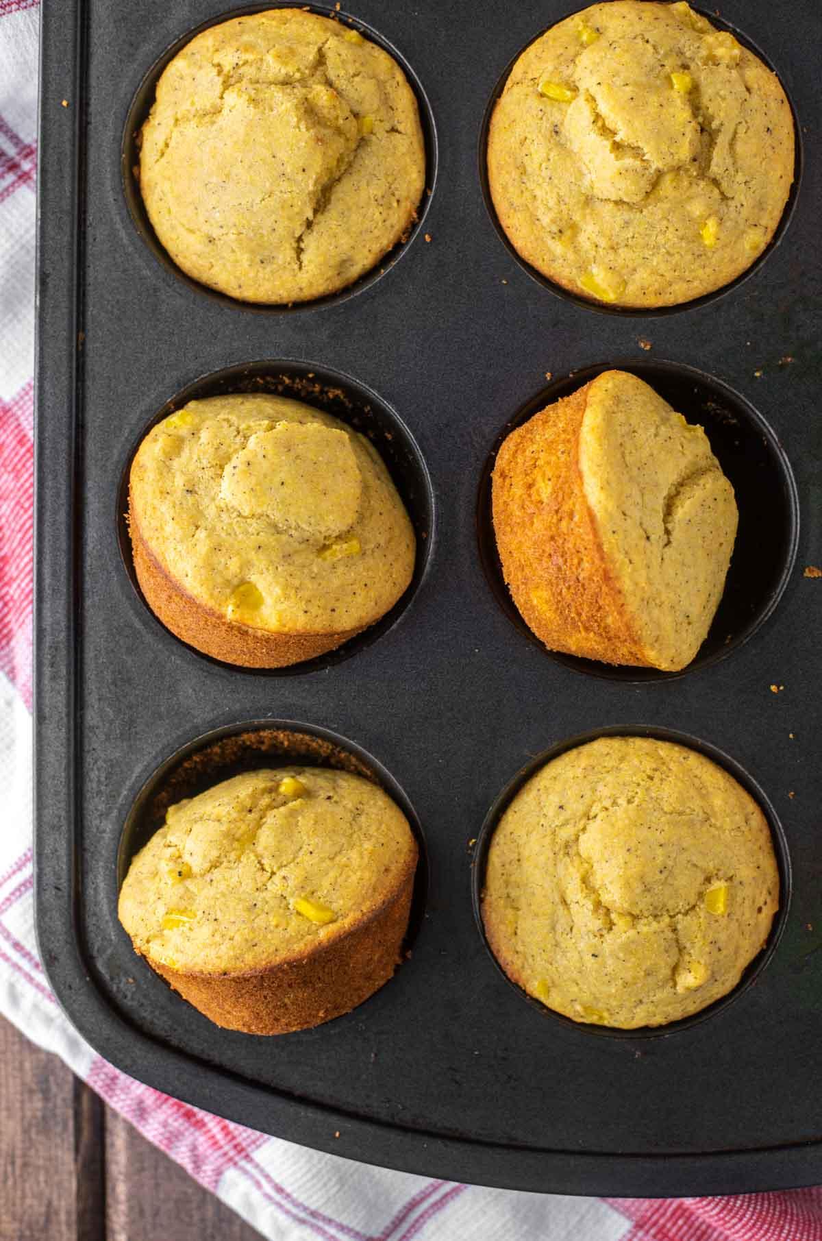overhead shot of cornbread muffins in tin
