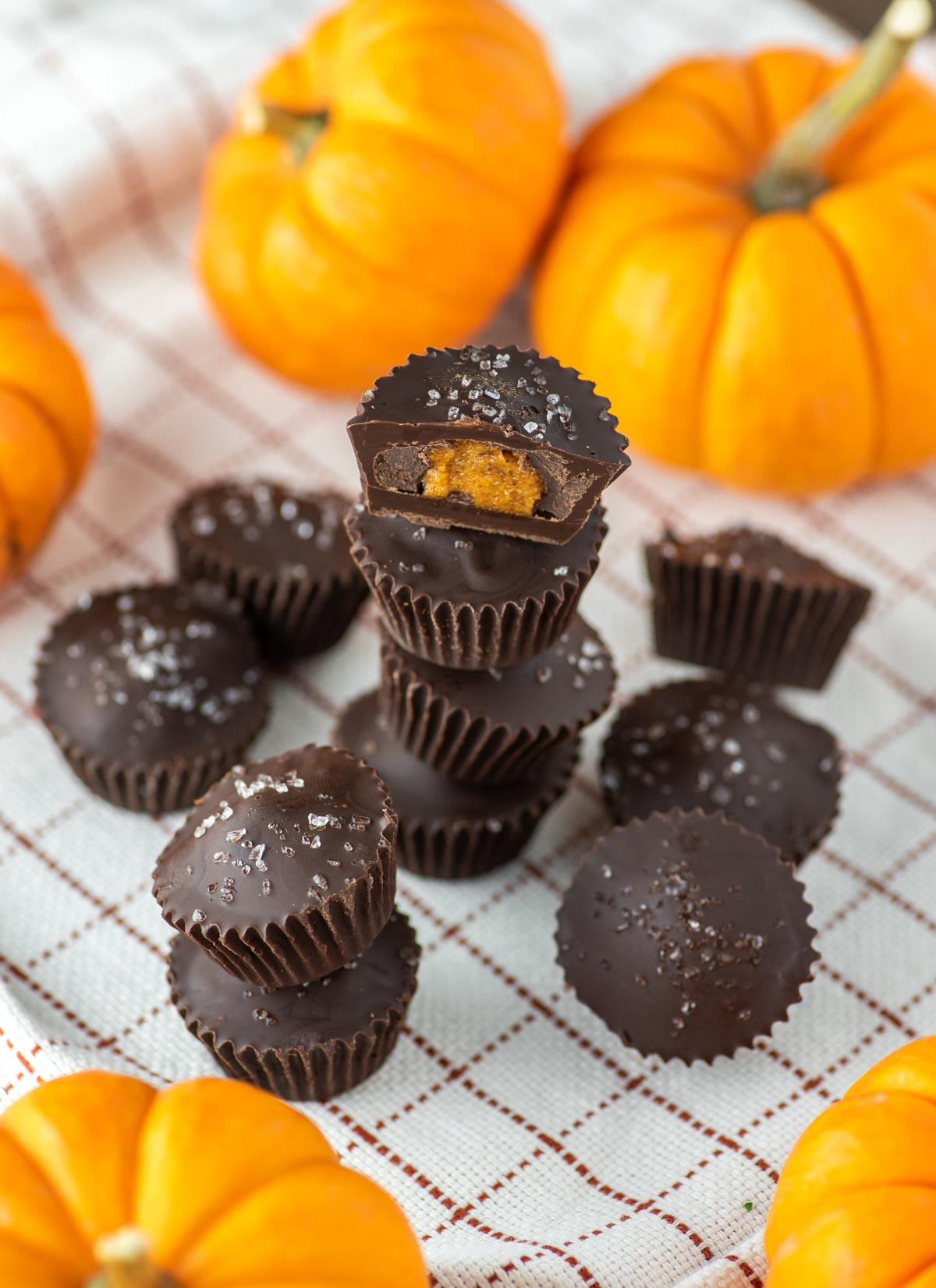 stacked chocolate pumpkin cups on dish towel
