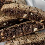 chocolate hazelnut biscotti stacked on white plate