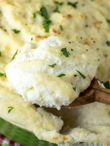 wooden spoon dipped in cream cheese mashed potatoes