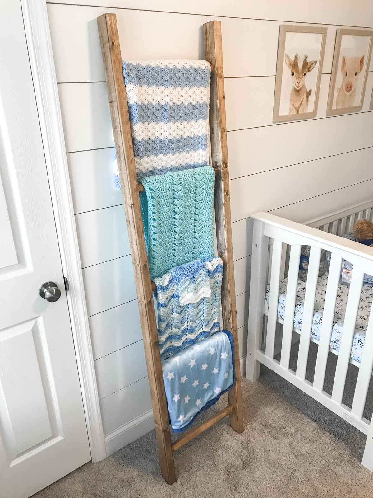 blanket ladder with 5 blankets against wall