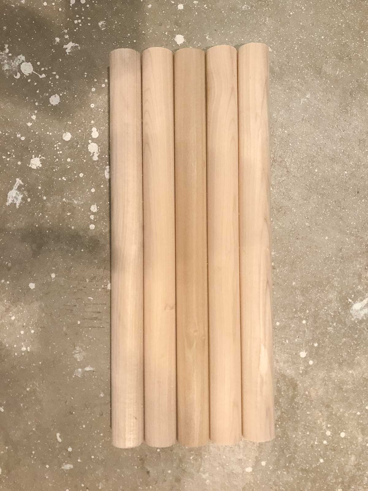 five 1 1/2 inch dowels cut to size and on floor