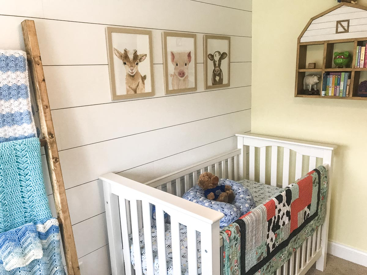 DIY shiplap on wall with crib against it