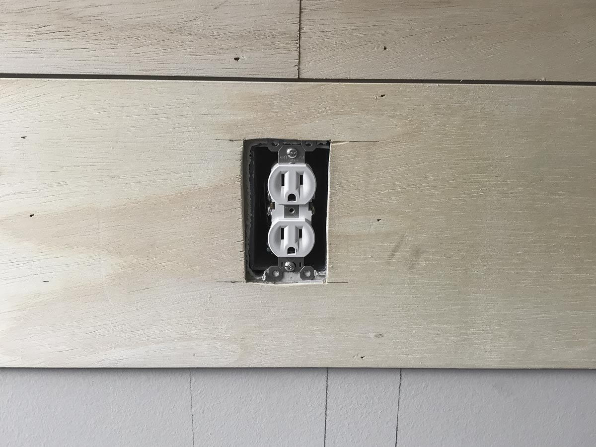 cut hole around plank for electric outlet