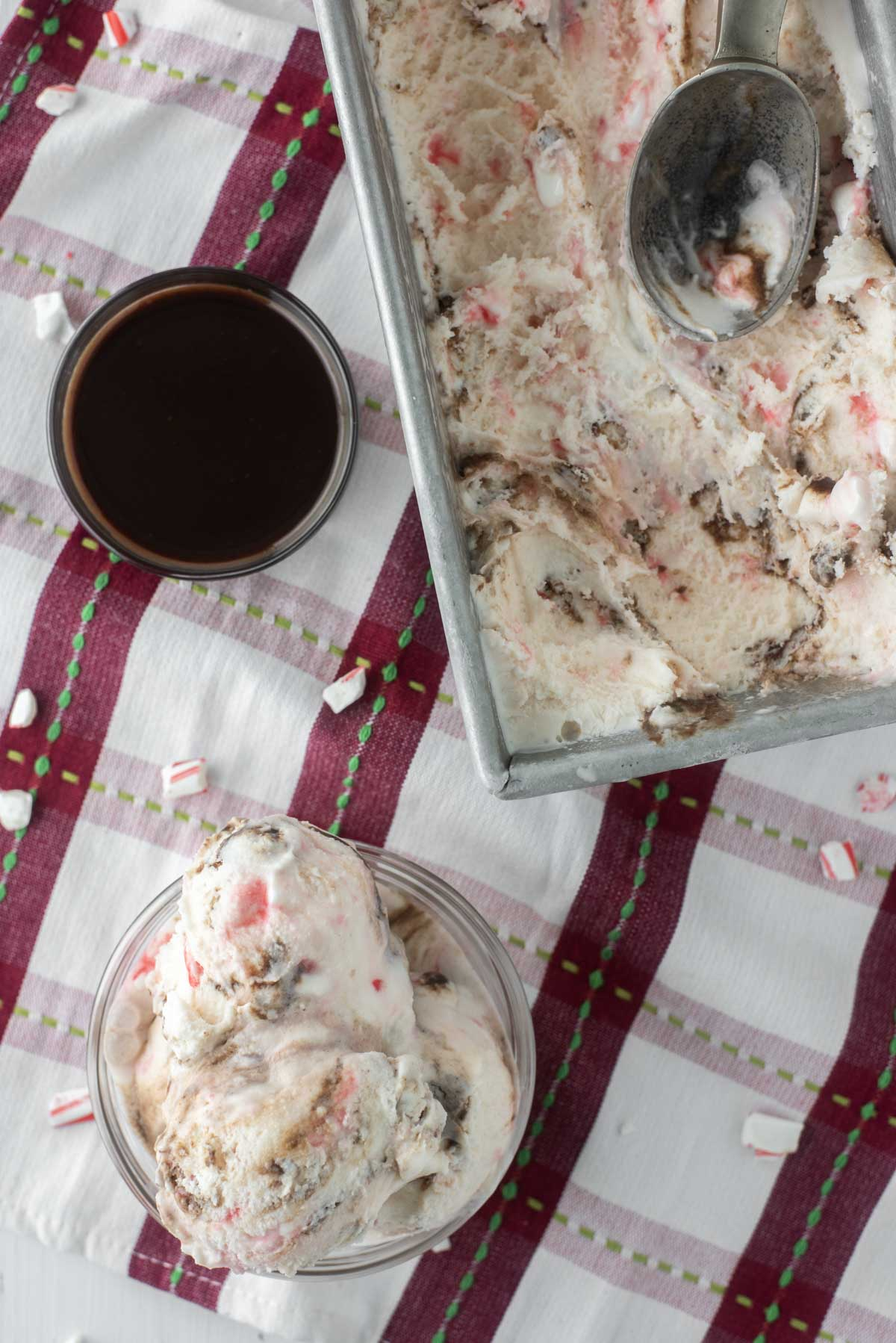 overhead shot of peppermint ice cream in glass bowl and metal tin