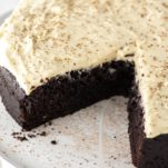sliced Guinness chocolate cake on white cake stand
