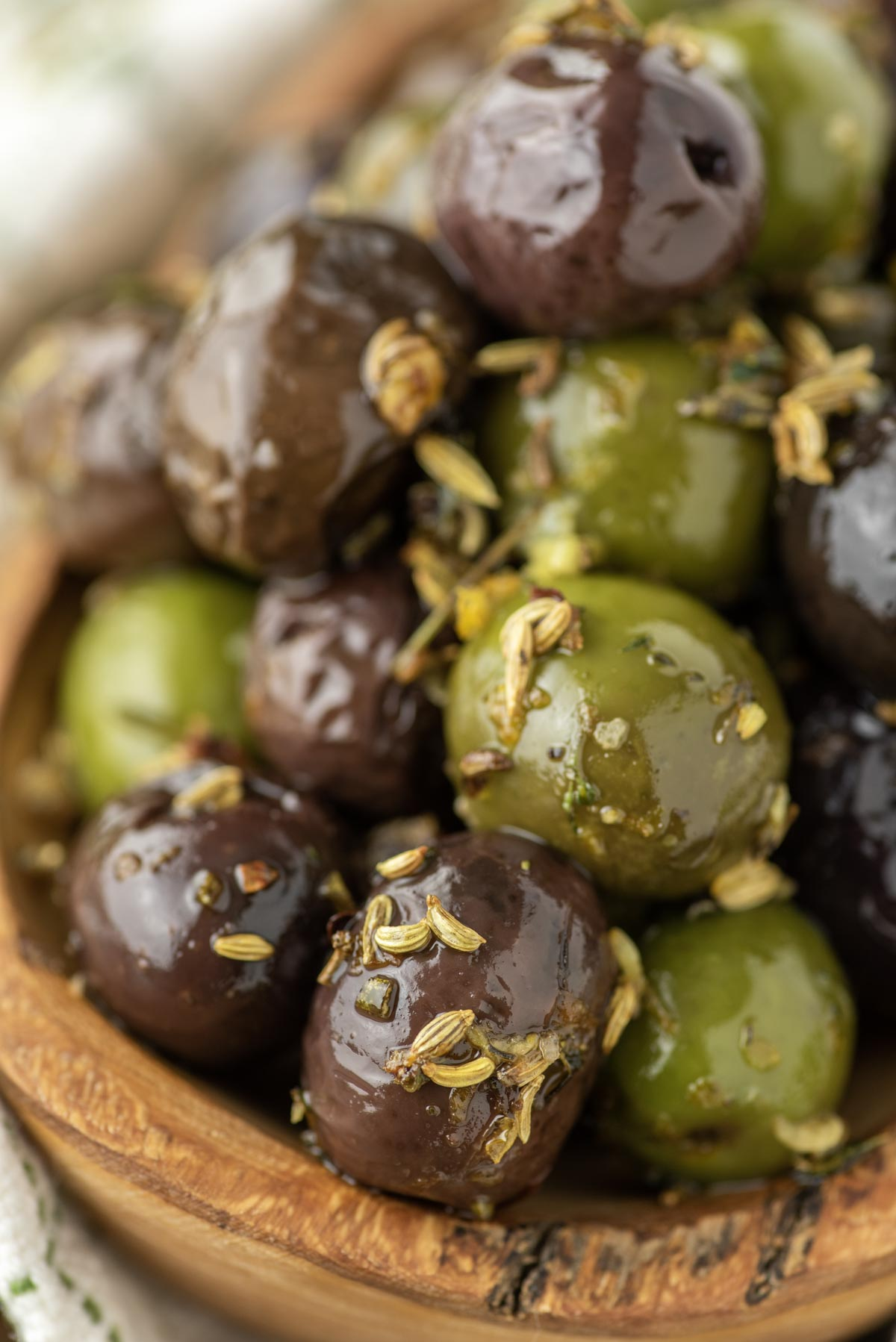 marinated olives in wood bowl