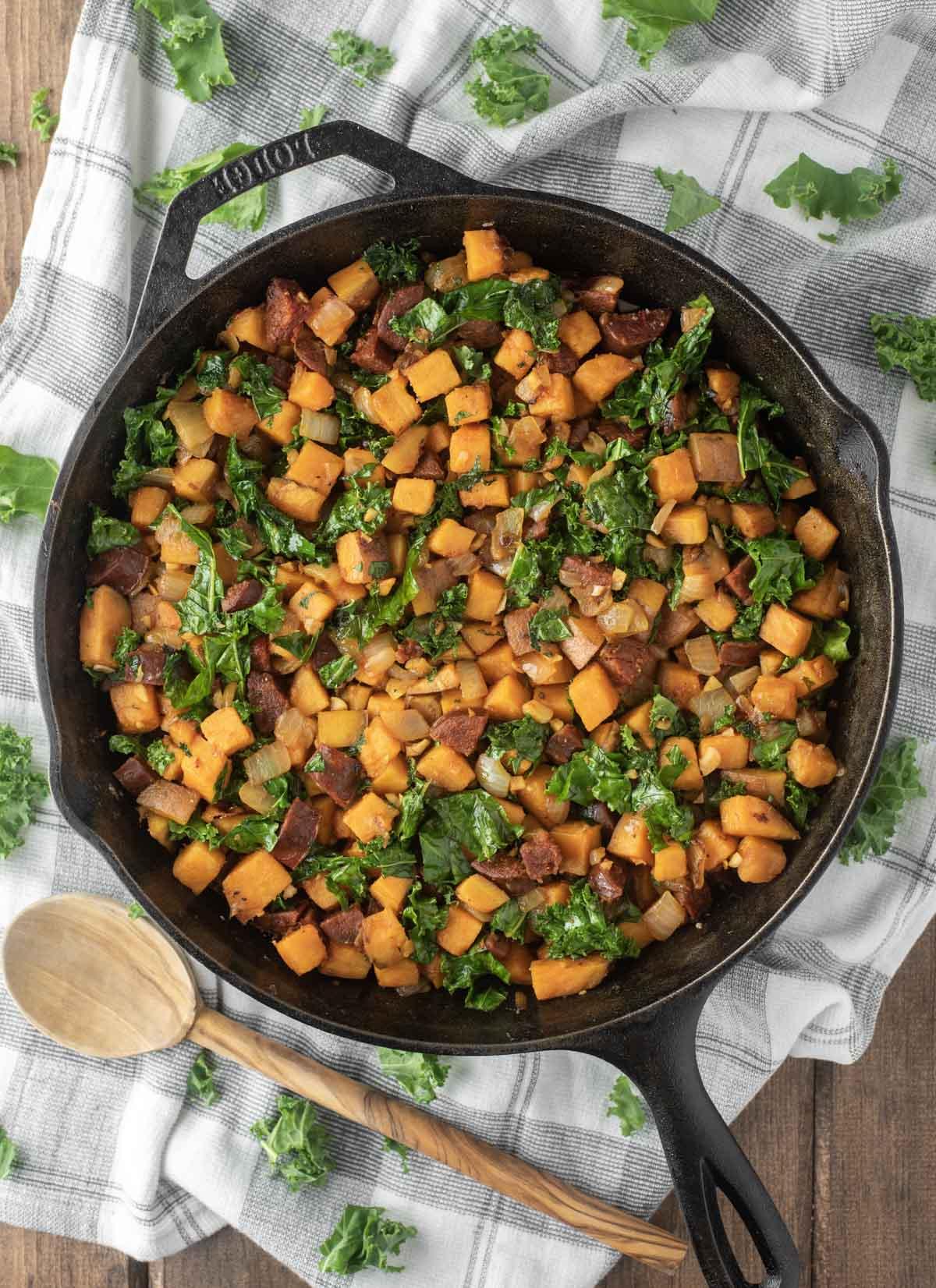 overlay of chorizo sweet potato hash in skillet