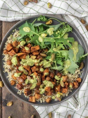 overhead shot of quinoa sweet potato salad in slate grey dish