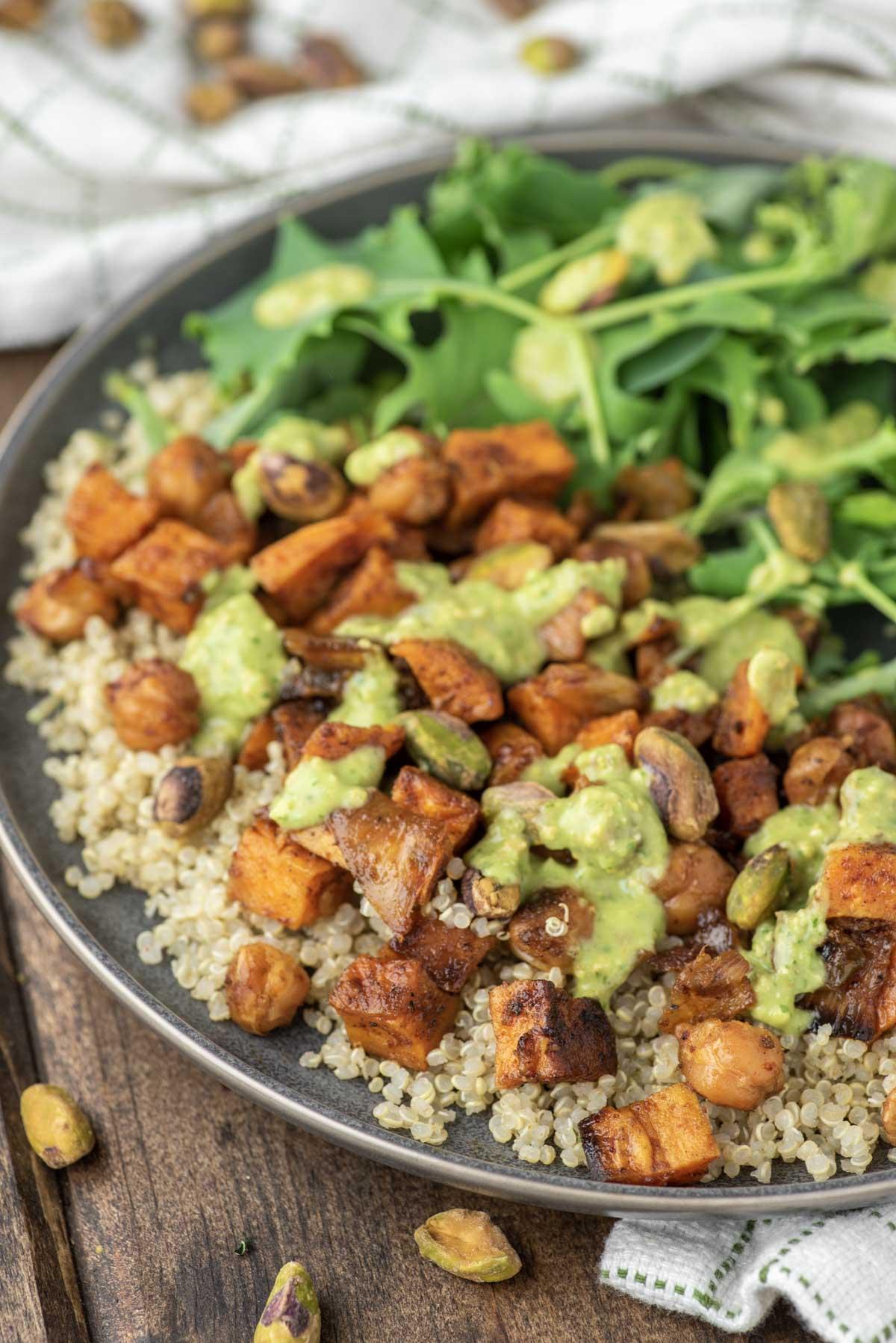 close-up of quinoa sweet potato salad in slate grey dish