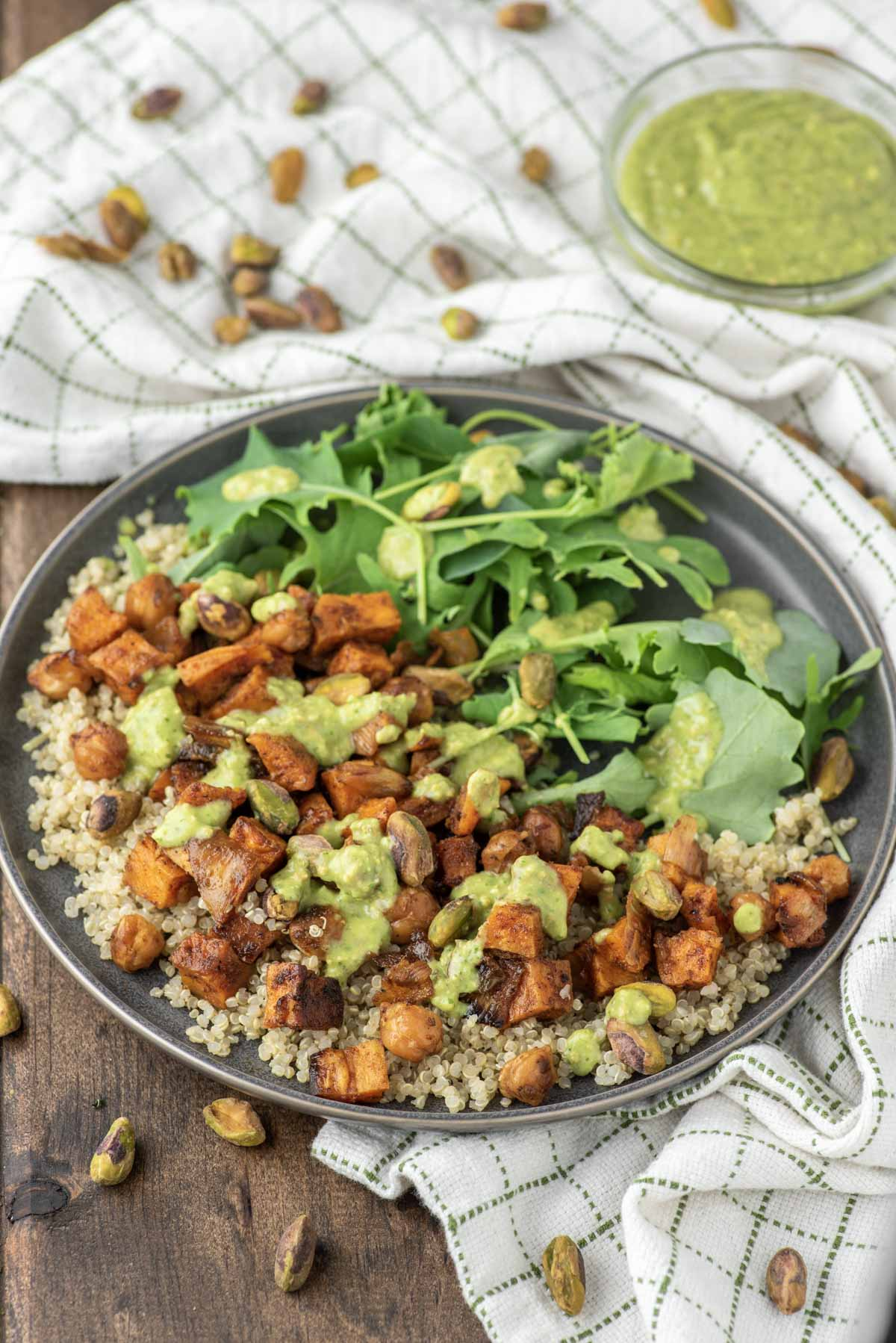 quinoa sweet potato salad in slate dish with dish towel in background
