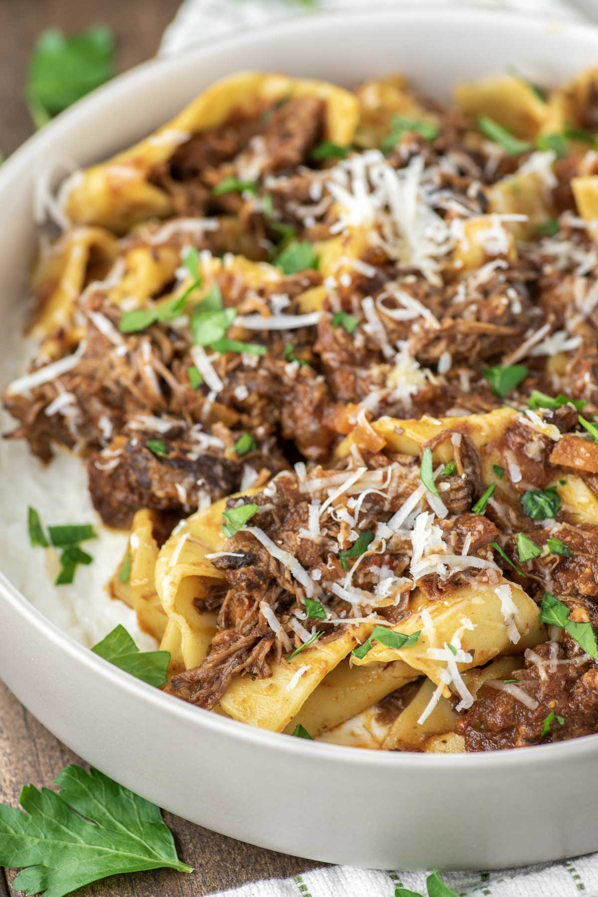 beef ragu with pappardelle in pasta bowl