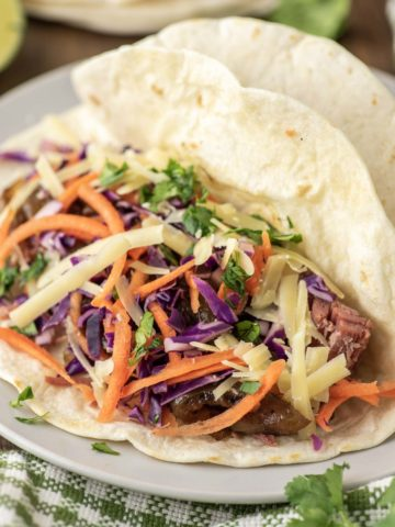 tortillas with corned beef and slaw on plate