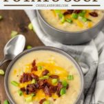 two grey bowls of potato soup topped with bacon and cheese