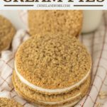 stacked oatmeal cream pies on dish towel with glass of milk in background