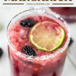 glass of blackberry margarita with lime