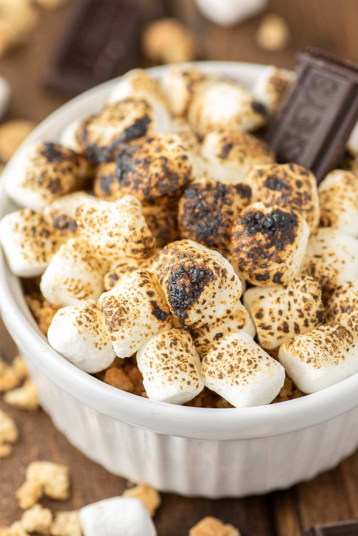 s'mores crème brûlée in white ramekin that is torched