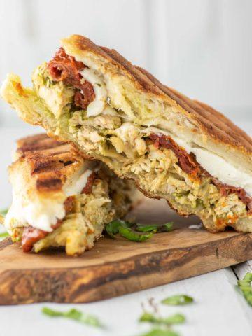 chicken pesto panini on wood board