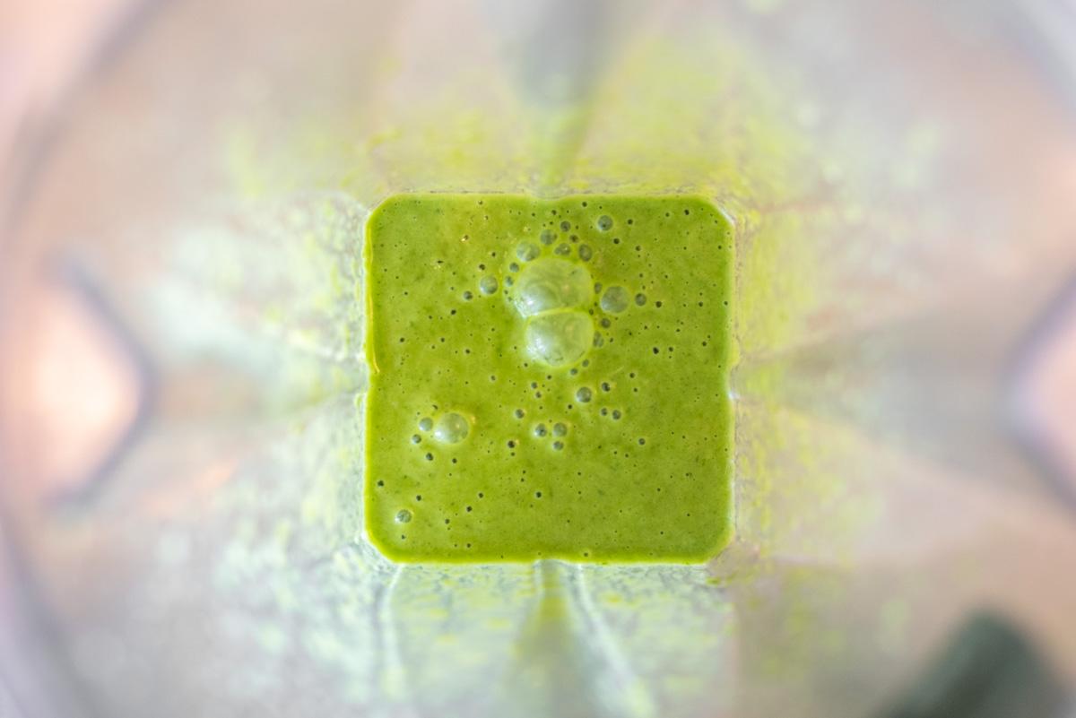 vinaigrette being blended in blender