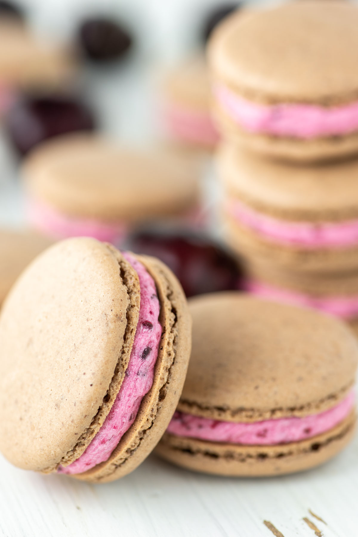 cherry macaron stacked against another with more in the background