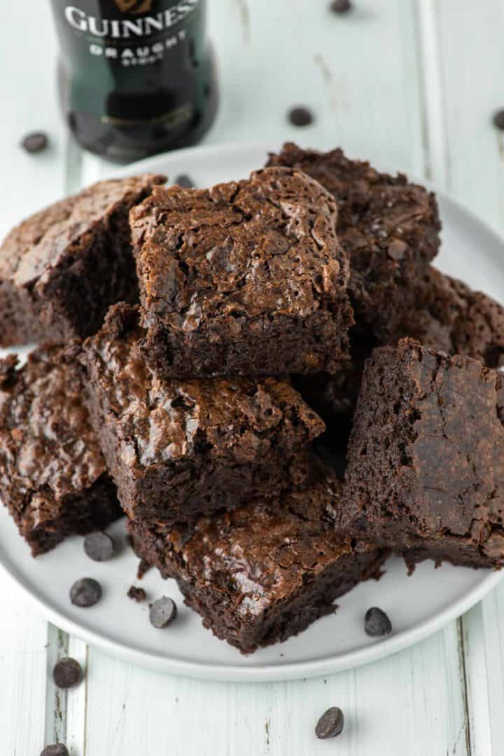 chocolate brownies stacked on white plate