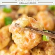 chopsticks picking up fried shrimp