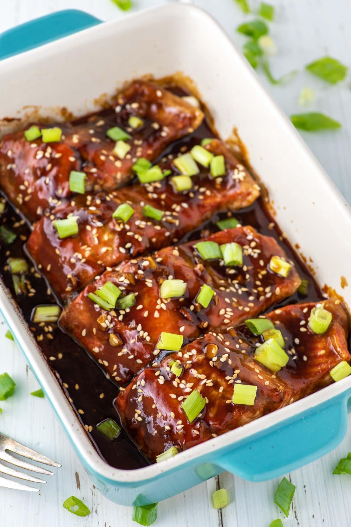 4 pieces of salmon in teriyaki sauce in baking dish