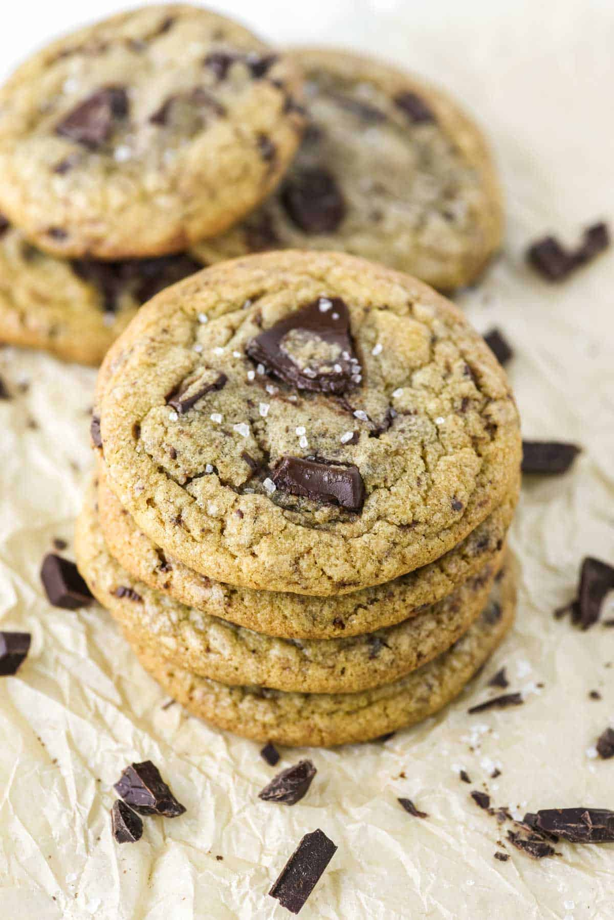 4 cookies stacked on top of each other on parchment paper