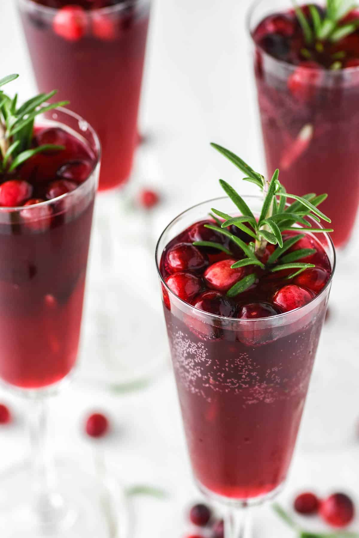 glass of mimosa with cranberry juice