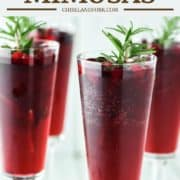 4 glasses of mimosas with cranberries