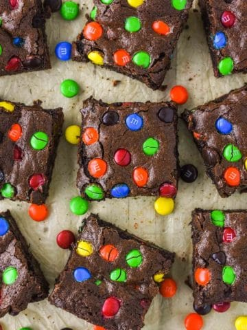 overhead shot of M&M brownies on parchment paper