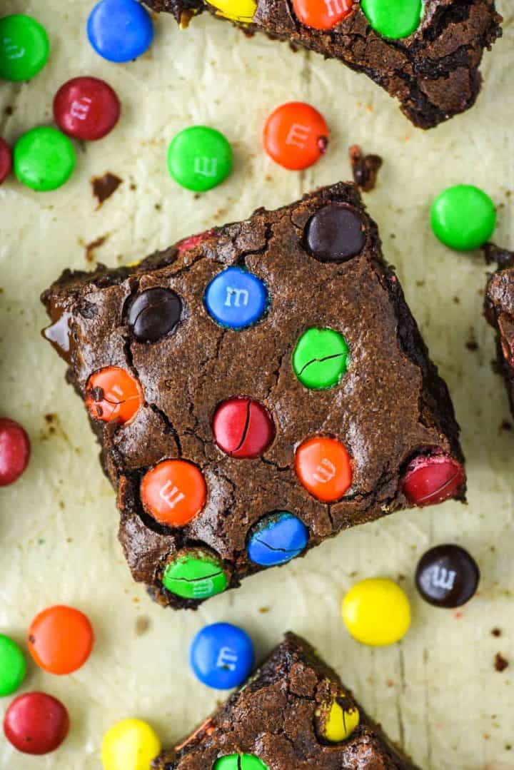 overhead shot of an M&M brownie on parchment paper