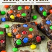 chocolate brownies with M&M's on parchment paper