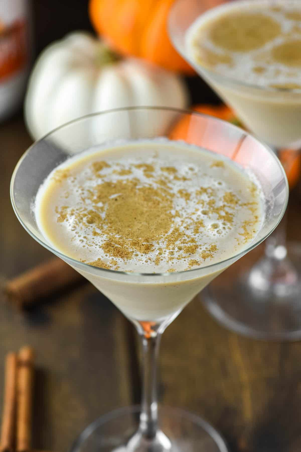 glass of martini with pumpkin and pumpkin pie spice sprinkled on top