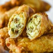 breakfast egg roll cut in half stacked on top of others