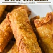 egg rolls with eggs, sausage and cheese on white plate