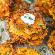 butternut squash fritters stacked with some goat cheese on top