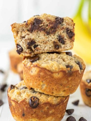 3 stacked almond flour banana muffins with one on top cut in half