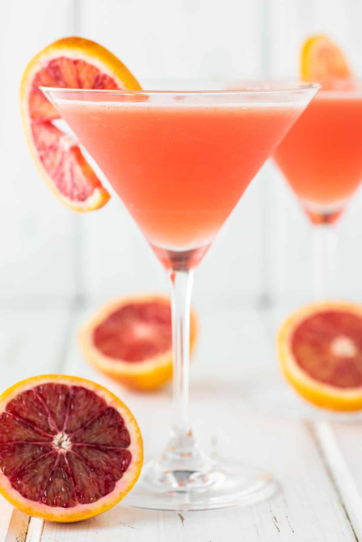 two glasses of martinis with blood oranges