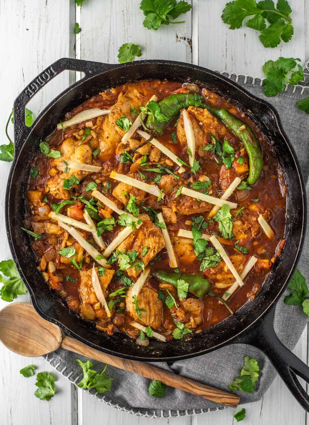 overhead shot of chicken karahi in cast iron skillet