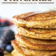 stacked pancakes with oat flour on plate and fruit