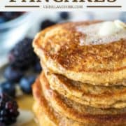 5 stacked pancakes with butter and fruit
